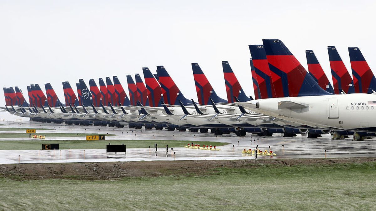 Delta employee makes Elmo mask to help passenger with special needs feel comfortable