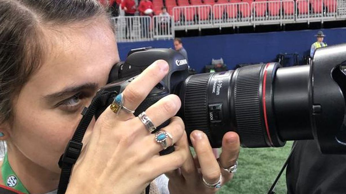 Injured UGA photographer back in action at SEC Championship game