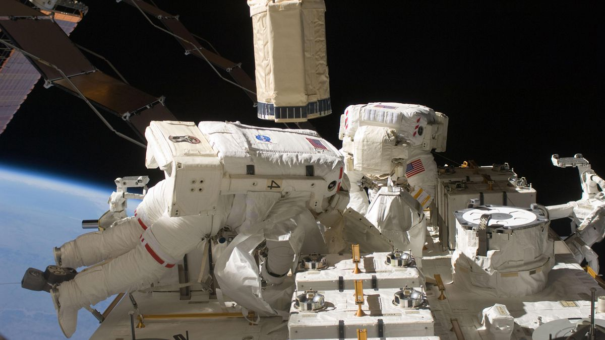 Spacewalking astronauts add new pumps to cosmic detector